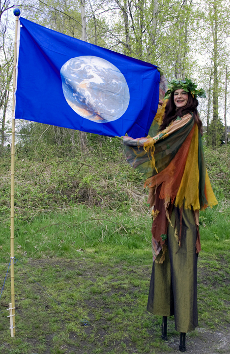 Foresta the Earth Goddess waves the Earth's flag at the Everett Crowley Park celebration, Earth Day 2009. PHOTO: E. Ayres